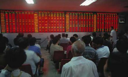 Asian markets mixed after Moody's downgrades China
