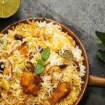 Shahi Biryani with layers of saffron rice and creamy mutton