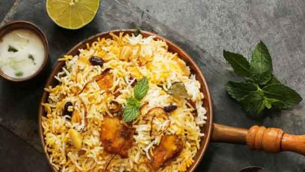 Shahi Biryani with layers of saffron rice and creamy mutton