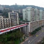 Chinese train that goes through block of flats