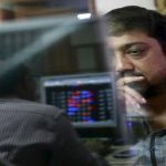 Sensex ends down 64 points in volatile trade