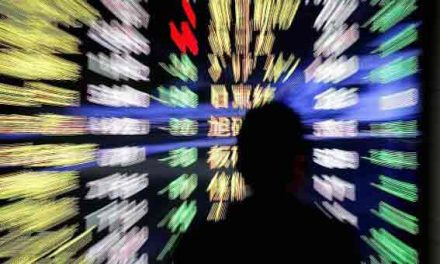 Asian shares mostly lower, investors note China GDP