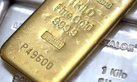 Gold rises after Fed minutes signal gradual rate hikes