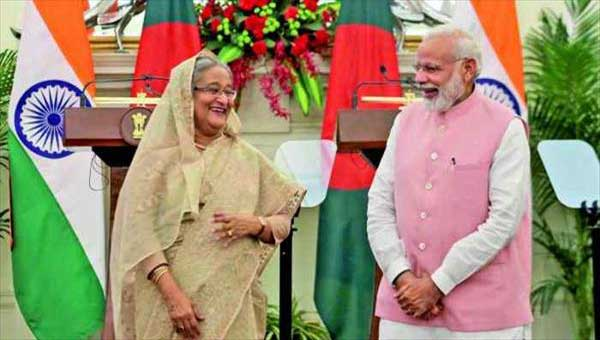 India, Bangladesh seal historic deals, condemn Pak terror