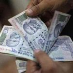 Rupee moves up 8 paise against dollar