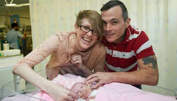 Baby girl survives being born with heart outside chest